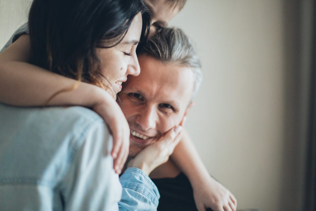smiling man with family